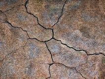 Bruine textuur van gebarsten muren, donkere achtergrond Royalty-vrije Stock Foto's