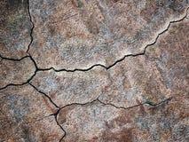 Bruine textuur van gebarsten muren, donkere achtergrond Stock Foto
