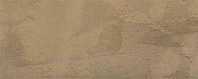 Bruine textuur van pleister, decoratieve deklaag voor muren in macrofotografie stock illustratie