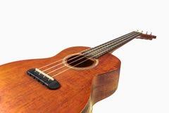Bruine ukelele, Hawaiiaanse die gitaar, op witte achtergrond wordt geïsoleerd Stock Afbeelding