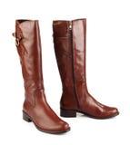 Bruine vrouwelijke laarzen Stock Foto's
