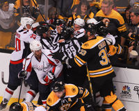 Bruins and Capitals fight. Members of the Boston Bruins and the Washington Capitals battle each other during the 2012 Playoffs, at TD Garden, Boston, MA Stock Images
