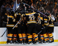 Bruins Celebrate!. Boston Bruins celebrate and overtime goal to give them a victory Royalty Free Stock Photos