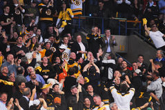 Bruins fans salute Bill Belichick. Boston Bruins fans acknowledge New England Patriots head coach Bill Belichick in attendance for a play-off game Stock Photography