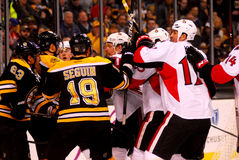 Bruins and Senators battle.  NHL Hockey Stock Photo