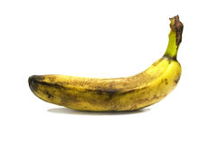 Bruised banana. Studio isolated photo of a riped banana Royalty Free Stock Image