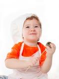 Bruits de gâteau de consommation de chef de bébé d'isolement sur le fond blanc Photos libres de droits