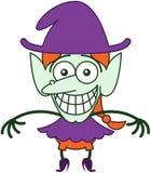 Bruja agradable de Halloween que hace muecas mientras que siente desconcertado Fotos de archivo