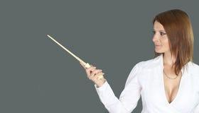 Bruja atractiva que sostiene una vara mágica Imágenes de archivo libres de regalías