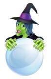 Bruja y bola de cristal Imágenes de archivo libres de regalías