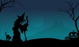 Bruja y gato de Halloween con los fondos azules Foto de archivo
