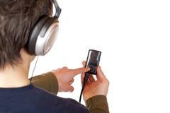bruk för tonåring för spelare för hörlurar med mikrofonmp3-musik Fotografering för Bildbyråer