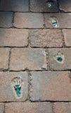 Bruk z odciskami stopy, tło Zdjęcie Stock