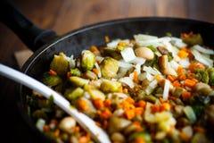 Brukselskie flance piec z warzywami i fasolami fotografia stock