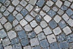 Brukuje droga chodniczka Kamiennego tło Zdjęcia Stock