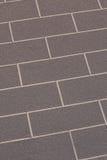 Brun abstrac för closeup för tegelstenvägg arkivbilder