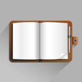 Brun anteckningsbok Arkivfoto