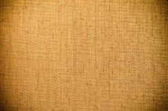 Brun bakgrund för Grungetextilkanfas Royaltyfri Bild
