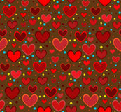 Brun bakgrund för röda hjärtor Royaltyfri Foto