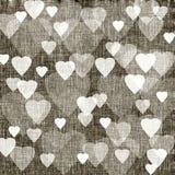 Brun bakgrund med hjärtor, linnetextur Royaltyfria Bilder