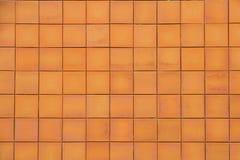 Brun bakgrund och textur för lergodsgolvtegelplatta sömlös Royaltyfri Fotografi