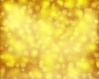 Brun d'or de bokeh de fond Images stock