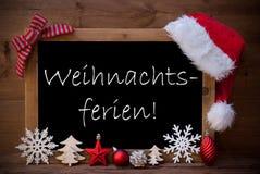 Brun ferie för jul för svart tavlahattWeihnachtsferien hjälpmedel arkivfoton