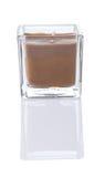 brun fyrkant för stearinljusbehållareexponeringsglas Arkivfoto