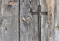 Brun gammal kristen form för religionsymbolkors arkivbilder