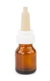 Brun glass liten medicinflaska med nasala droppar Royaltyfria Bilder