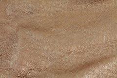 Brun grönsak garvad läderbakgrundstextur Arkivbild
