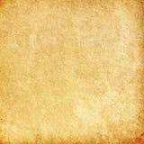 Brun grungebakgrund, gammal pappers- textur, apelsin, buse, fläck Arkivfoto