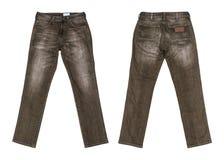 Brun jeans som isoleras på vit bakgrund med den snabba banan royaltyfri bild