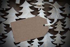 Brun juletikett med den kopieringsutrymme och ramen Royaltyfri Foto