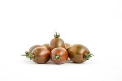 Brun körsbärsröd tomat - Kumato Royaltyfri Foto