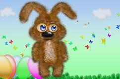 Brun kanin och dekorerade ägg för easter Arkivbilder