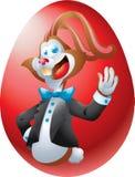 Brun kanin på det röda ägget Royaltyfria Bilder