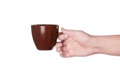 Brun kopp kaffe i hand Arkivfoto