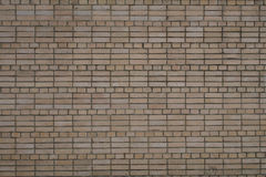 Brun kurvtegelstenvägg för textur och bakgrund Fotografering för Bildbyråer