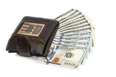 Brun läderplånbok med hundra USA-dollar Arkivbild
