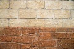 Brun och beige textur för bakgrund för stenvägg Arkivbilder