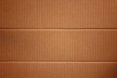 Brun papptextur som en bakgrund papp återanvänder arkivfoton