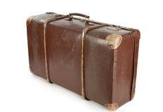 Brun resväska som isoleras på vit Arkivfoto