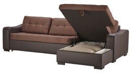 Brun säng för läderhörnsoffa Royaltyfria Foton