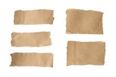 Brun sönderriven pappersuppsättning Royaltyfri Bild