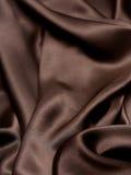 Brun silk bakgrund Arkivbilder