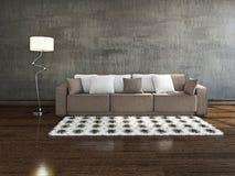 Brun soffa nära väggen Arkivfoton