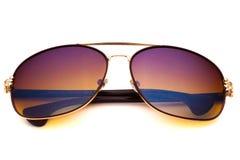 Brun solglasögon som isoleras på den vita bakgrunden Royaltyfri Bild