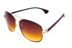 Brun solglasögon som isoleras på den vita bakgrunden Royaltyfri Foto
