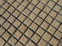 Brun stenmodell i bakgrundstextur Arkivbild